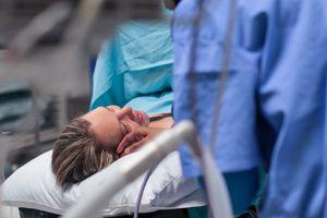 Person giving birth.