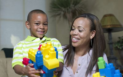 little boy and his mom playing with legos