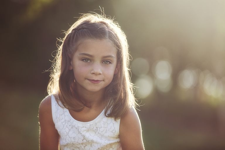cute, brown haired hazel eyed girl at sunset