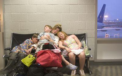 Family sleeping at airport