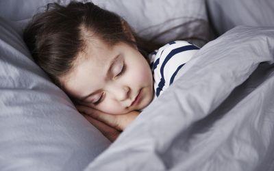 child sleeping under weighted blanket