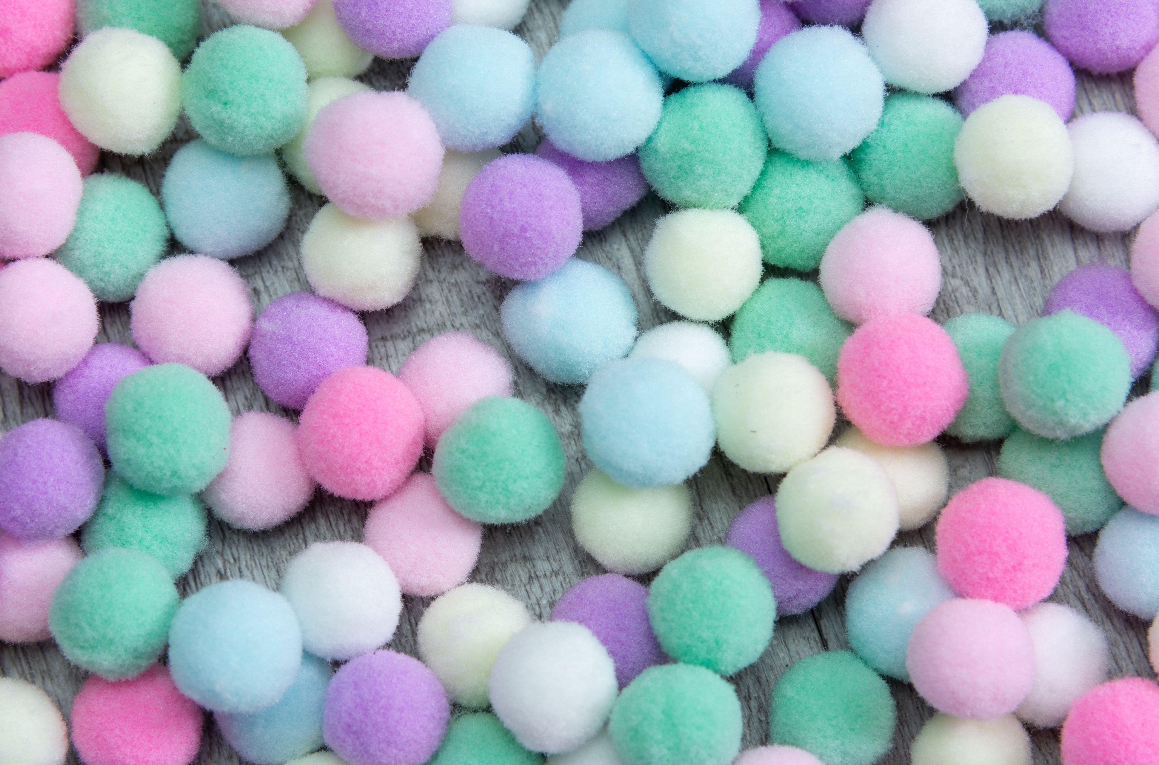 A sweet colorful Pom Pom background
