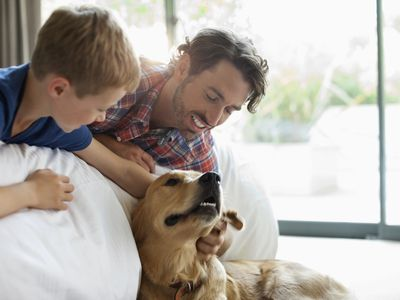Parent with dog and child