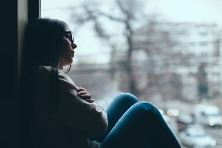upset girl in window