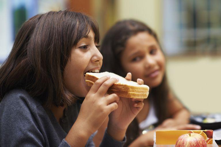 Enjoying a sandwich during recess