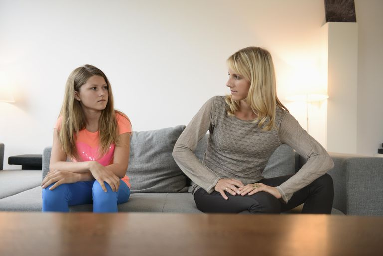 Mid adult woman looking annoyed with daughter
