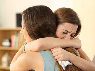 girl comforting crying girl