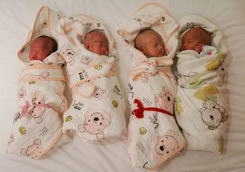 swaddled babies