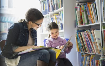 woman and little girl reading