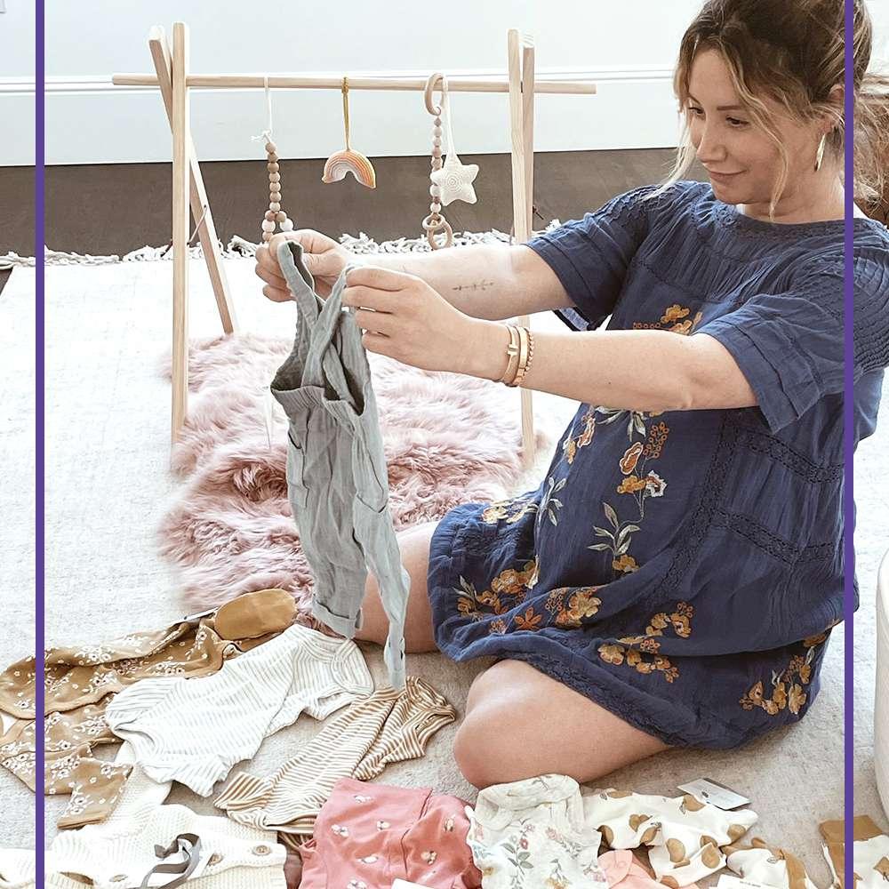 Ashley Tisdale folding baby clothes