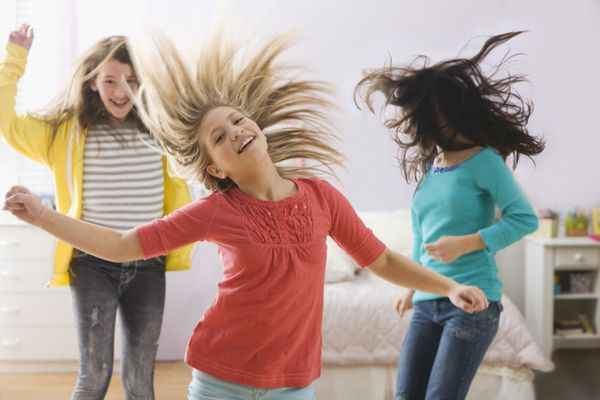 Three girls dancing