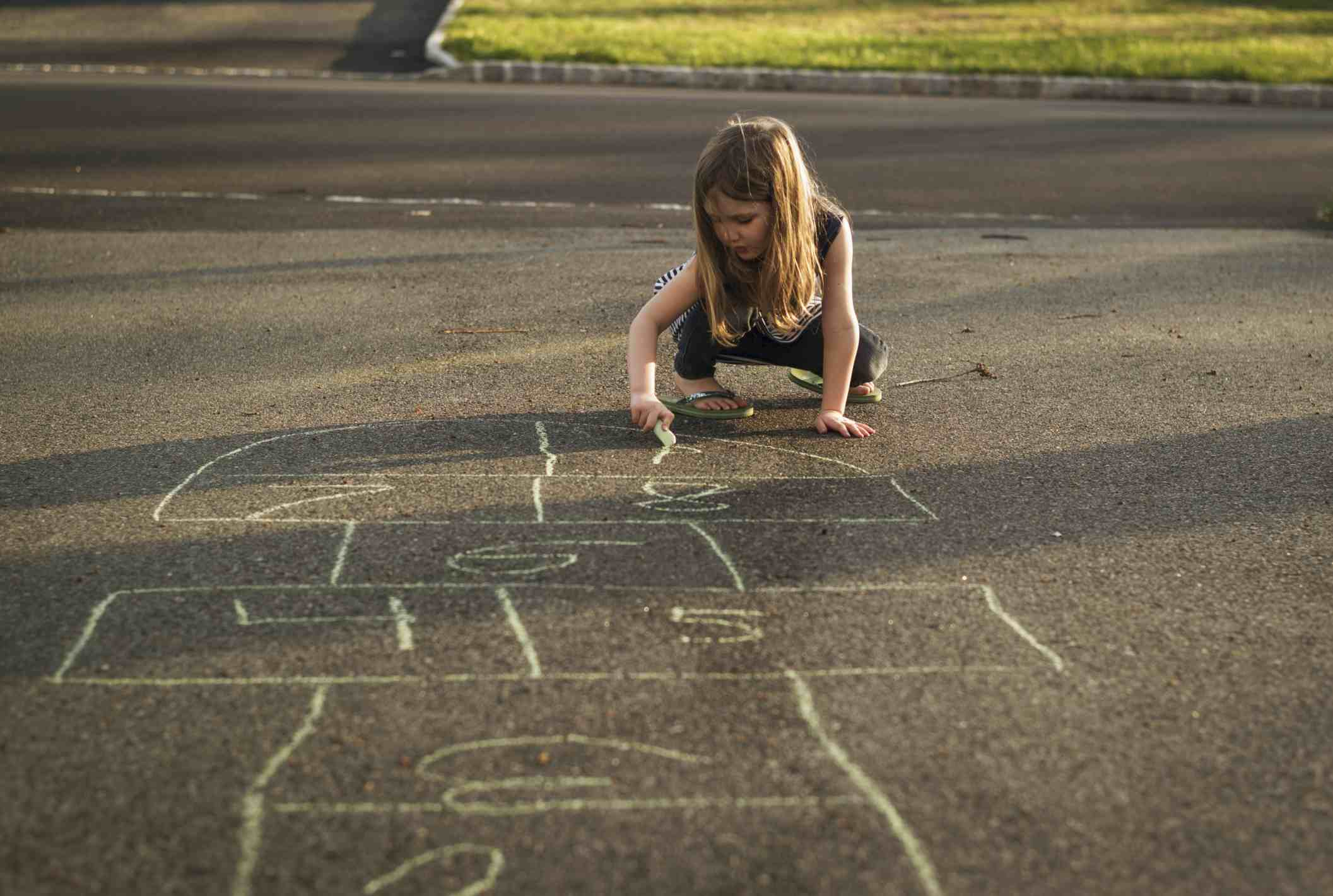 Girl drawing Hopscotch board