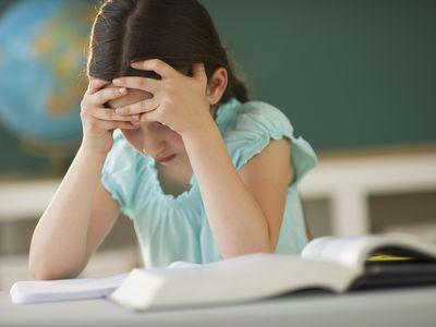 Schoolgirl (8-9) reading book