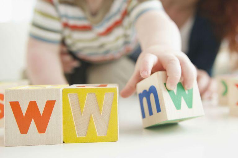 Baby boy spelling WWW with blocks