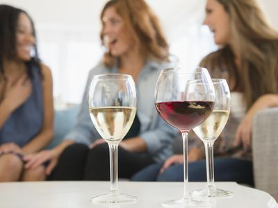 Wine glasses with women in the background