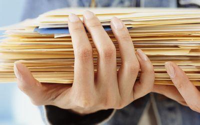 Woman holding folders, close-up