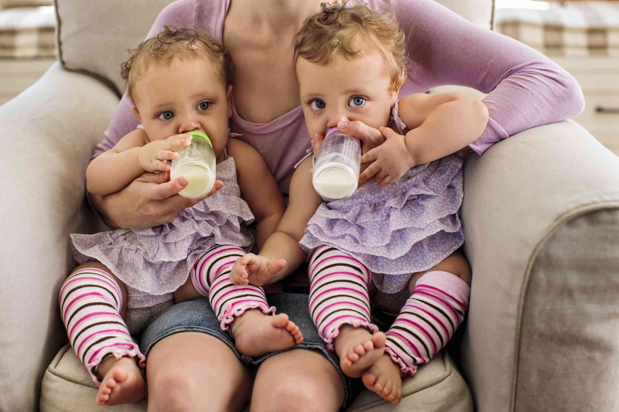 Twin babies in matching outfits