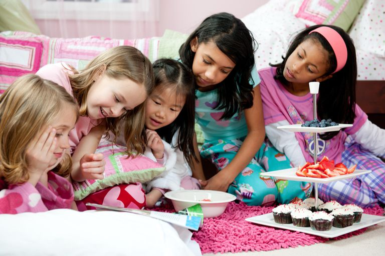 tween girls sleepover party with magazines and food