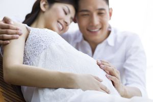 Happy pregnant woman and husband