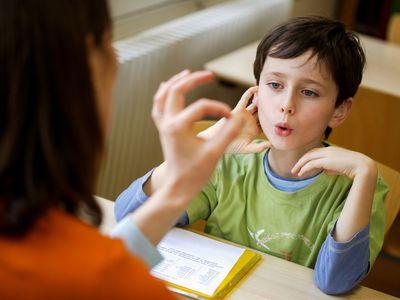 Boy working with a speech therapist