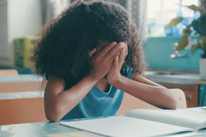 young girl upset in classroom