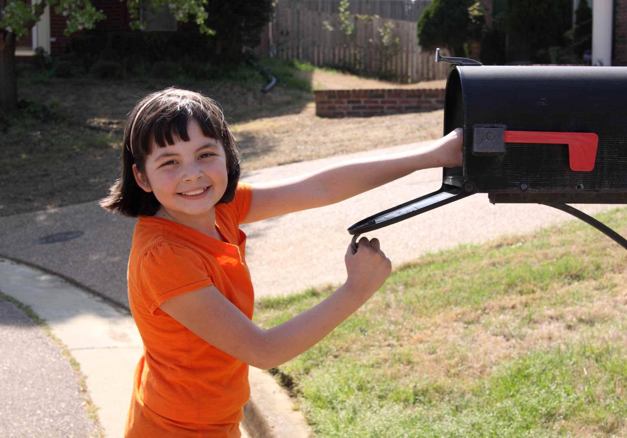 Child sending a letter to a grandparent