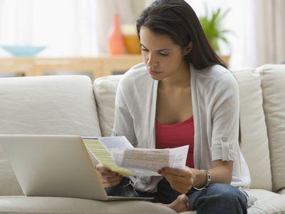 Hispanic woman paying bills online