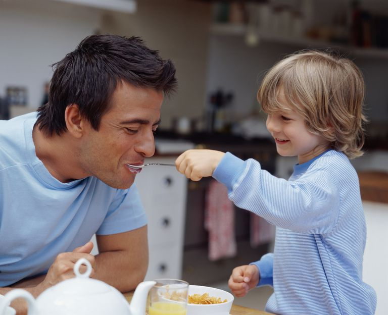 A single dad having breakfast with his son