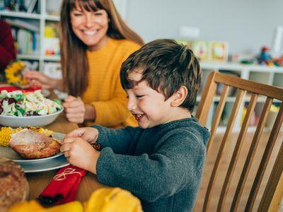 Happy kid eating at thanksgiving