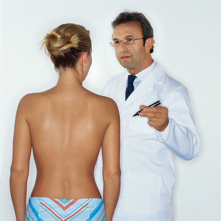 Doctor examining a woman's breasts