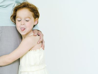 rude behavior in kids - girl sticking out her tongue