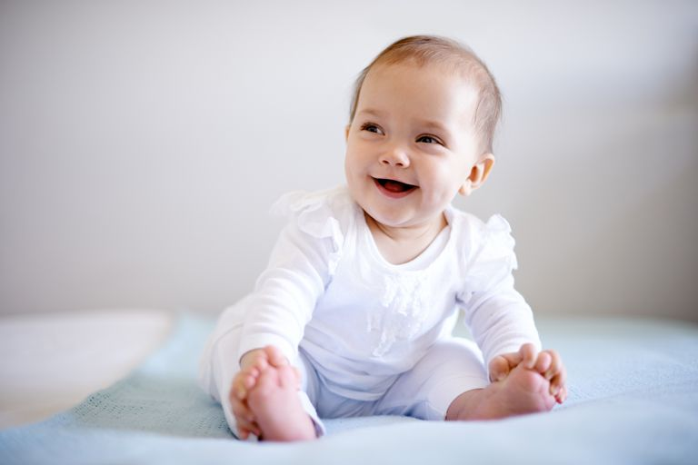Smililng baby sitting up