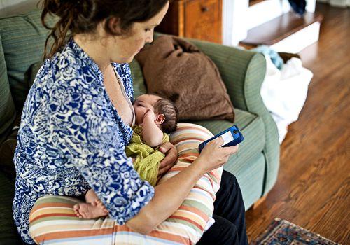 Woman using breastfeeding tracker