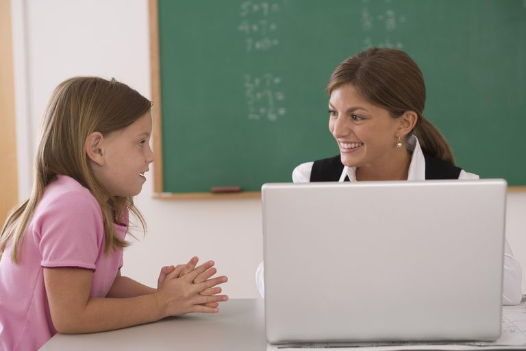 Teacher with her laptop and student