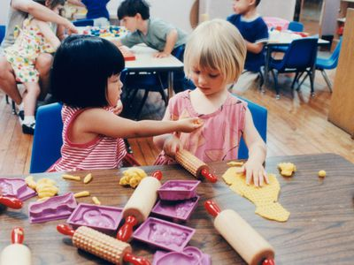 Preschool-aged girls playing with playdough