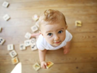 A 9 months old baby playing