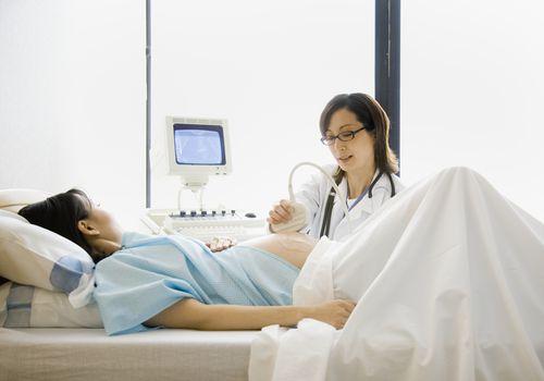 Pregnant woman having ultrasound scan