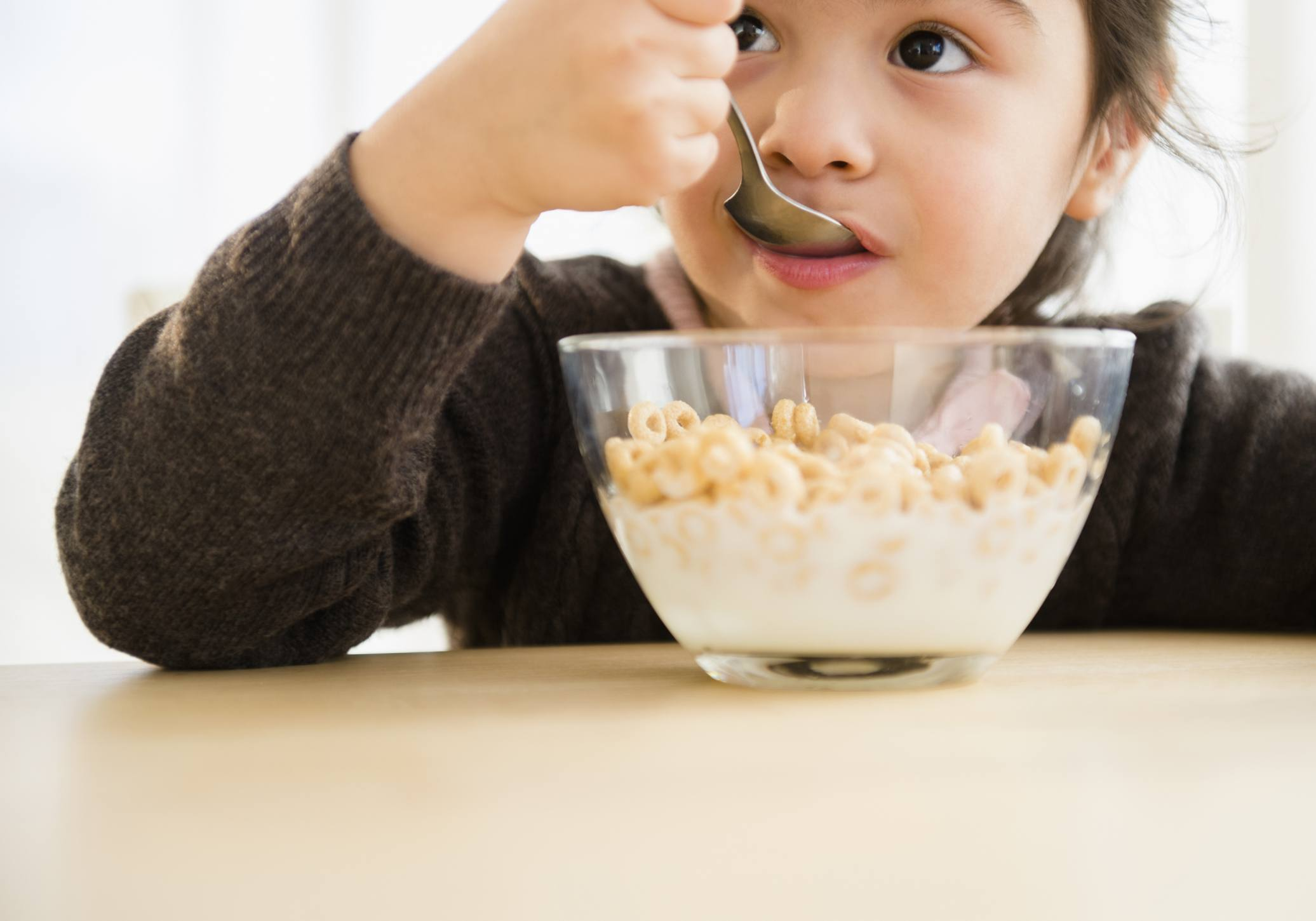 preschooler eating a bowl of cereal.
