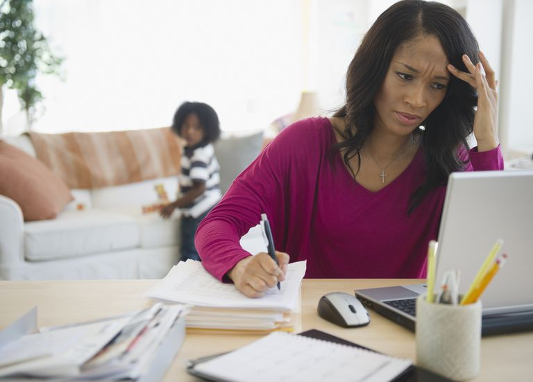 Frustrated African American woman working from home