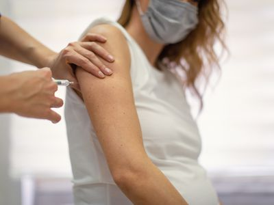 Pregnant woman receiving the covid-19 vaccine