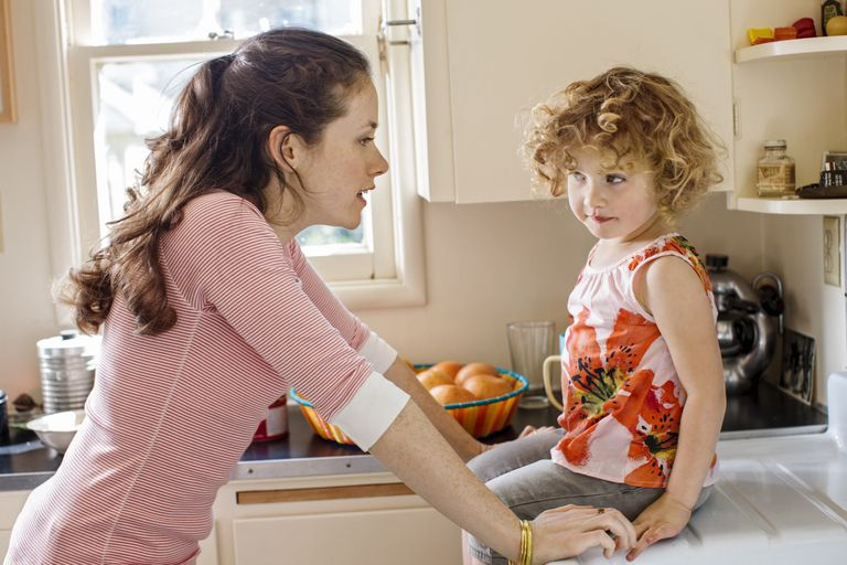 authoritative parenting - mother talking to daughter