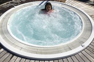 Young girl relaxing in jacuzzi