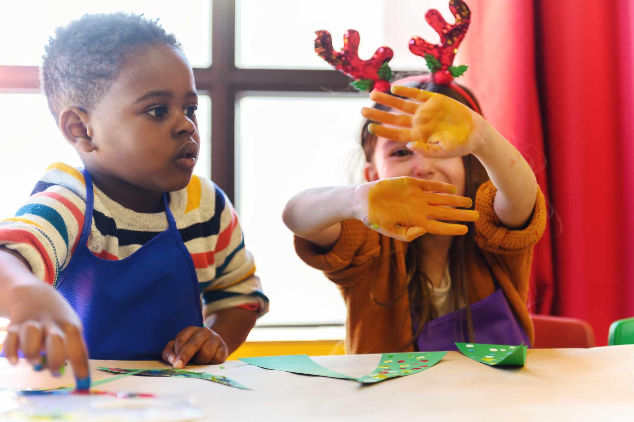 Preschoolers making Christmas crafts