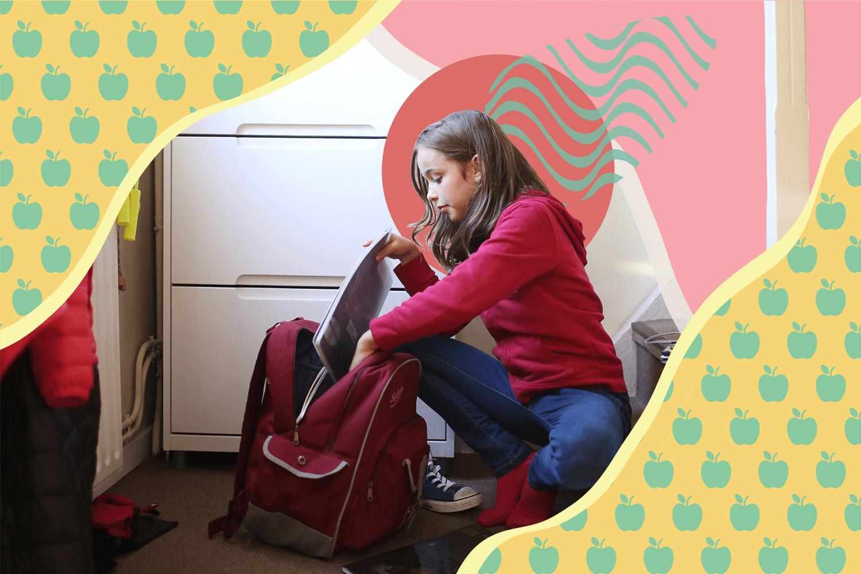 Little girl loading her backpack