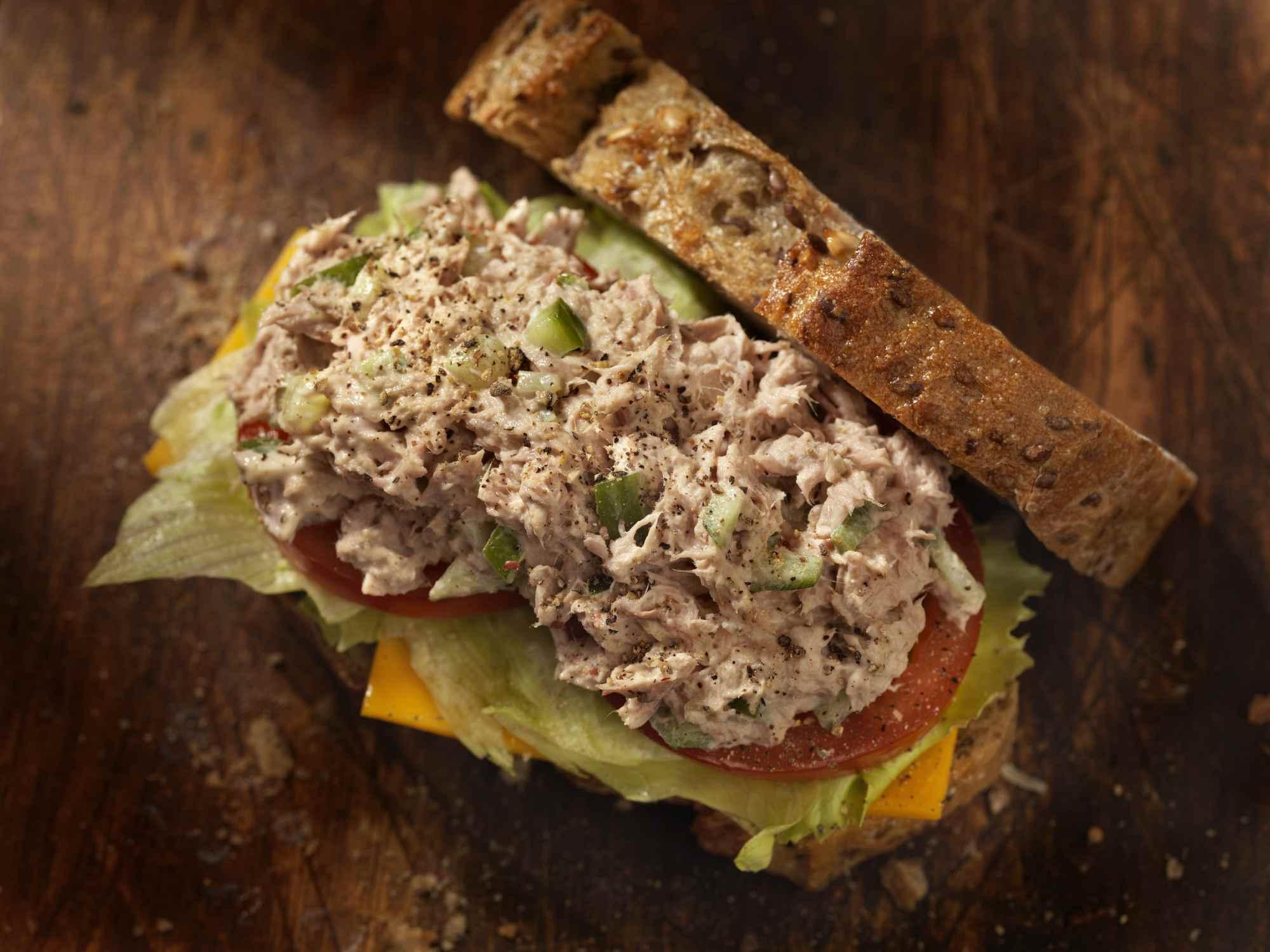 Tuna salad sandwich on wooden table