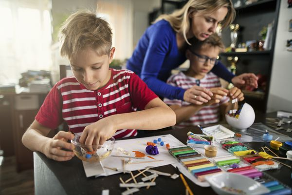 Boys doing crafts with their mom