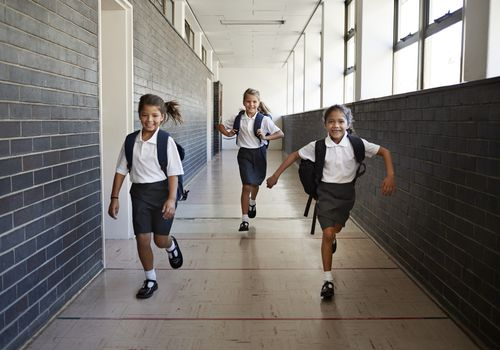 Catholic School girls running in hallway