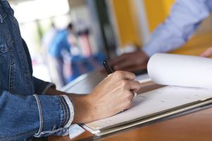 Woman filling out registration form at an event