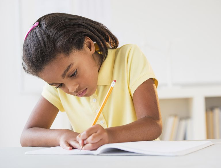 A girl writes with her left hand.