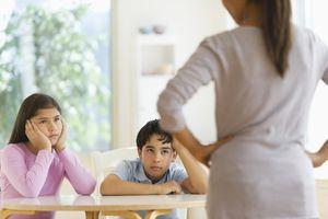 Mother scolding children